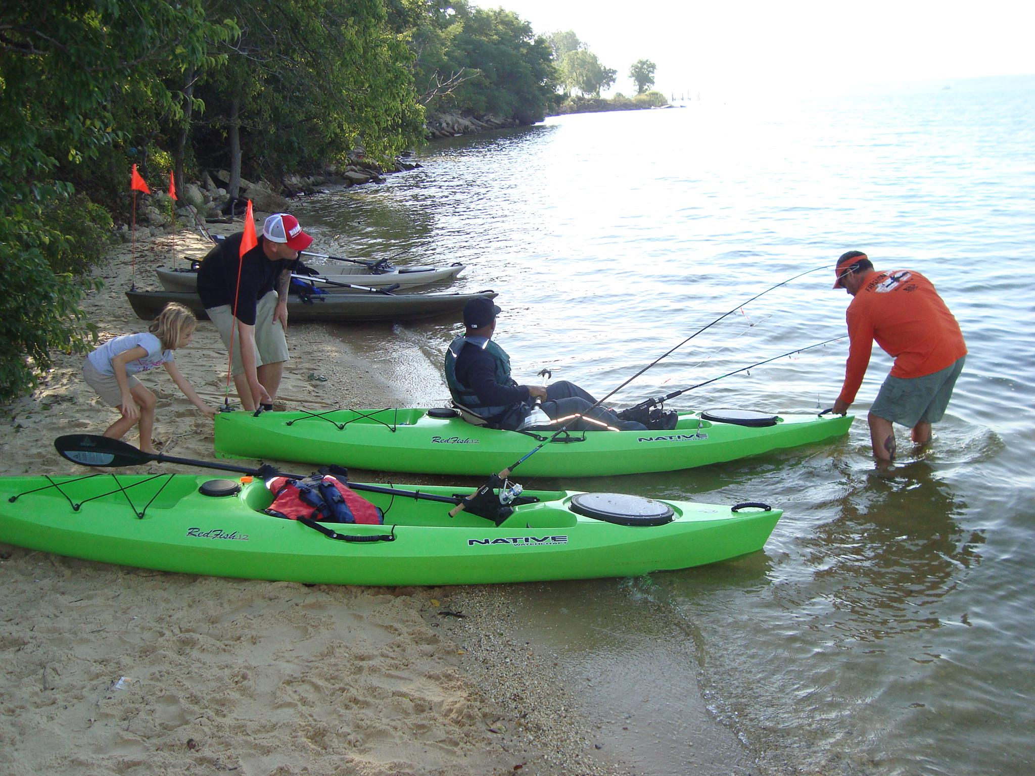 Blanchet helps launch a kayak into the water at Solomons Island, Maryland