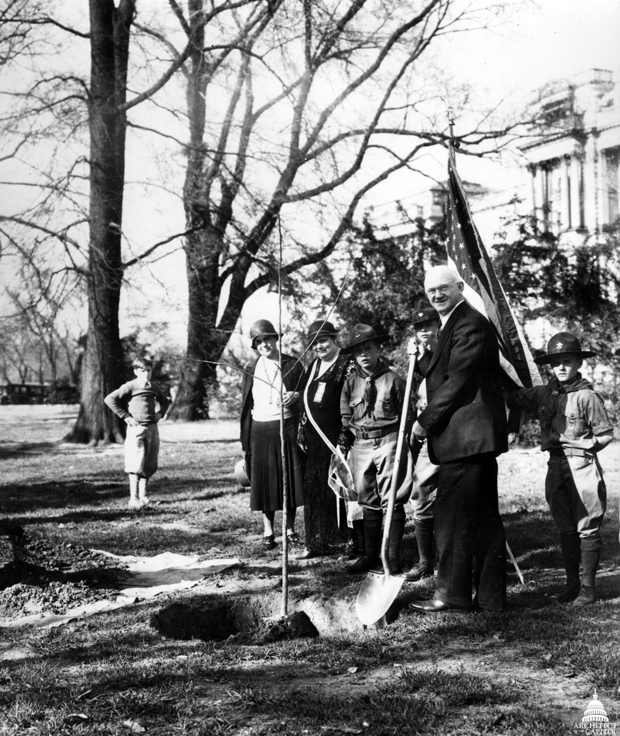 Major Robert Young Stuart, Chief of the U.S. Forest Service, planting an elm on East Front Lawn to honor the 100th anniversary of J. Sterling Morton, Founder of Arbor Day.