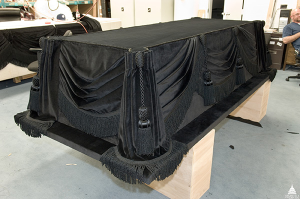 In 2006, the Architect of the Capitol carefully restored the fabric that covers the catafalque constructed by Job W. Angus and others to hold President Lincoln's casket as he lay in state.