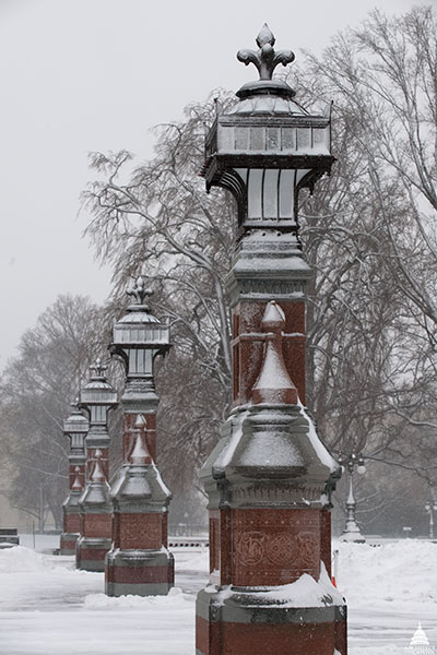 Olmsted lanterns on the U.S. Capitol East Front Plaza covered in snow.