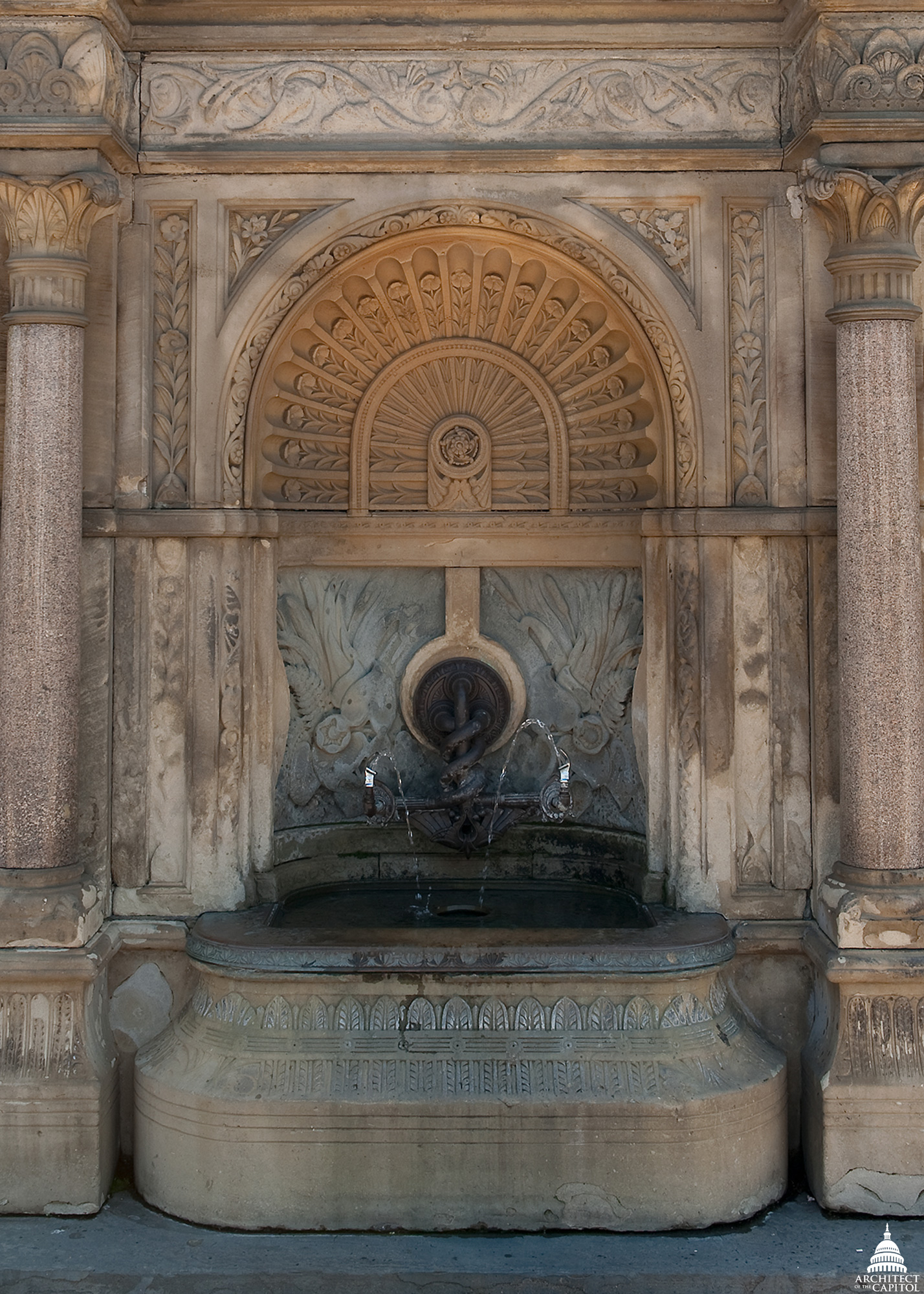 The central fountain in the perimeter wall surrounding Capitol Square.