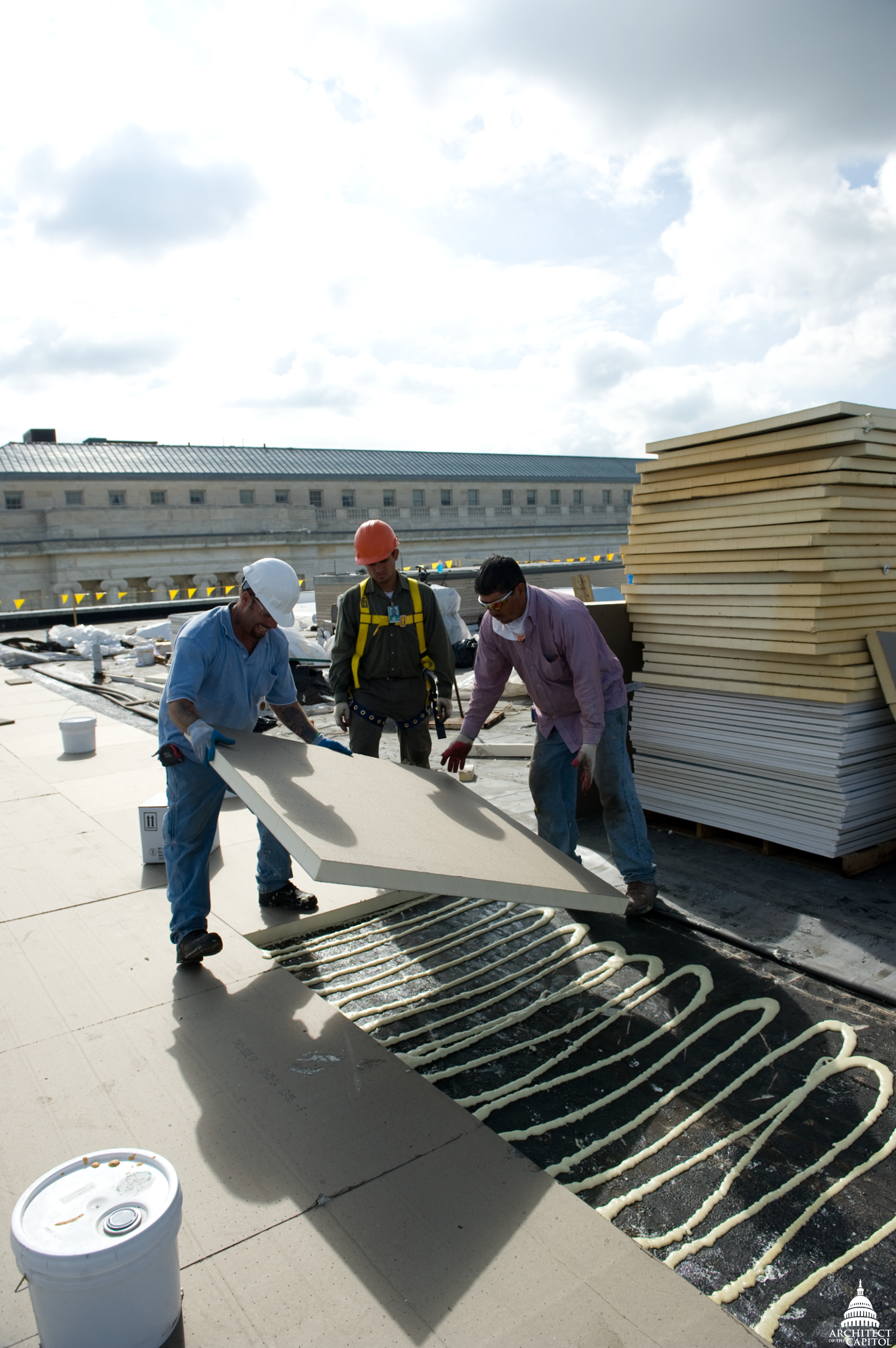 "Modifying the existing system Rayburn House Office Building into a ""cool roof."""