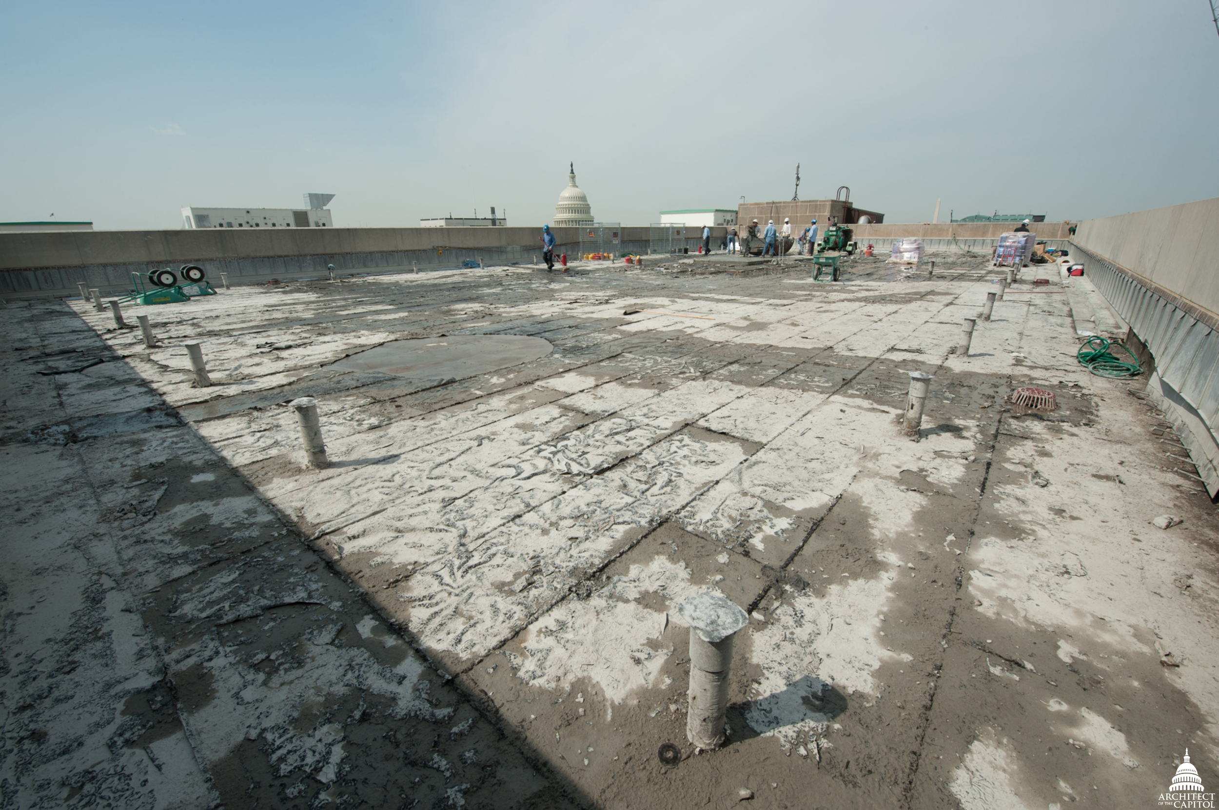 The old insulation and waterproofing visible on the Dirksen Building roof after the concrete was removed.