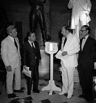 Unveiling and placement of the Lincoln desk marker in National Statuary Hall. Left to right: Representative Paul Findley, Speaker Carl Albert, Chairman Wayne L. Hays and 9th Architect of the Capitol George White.