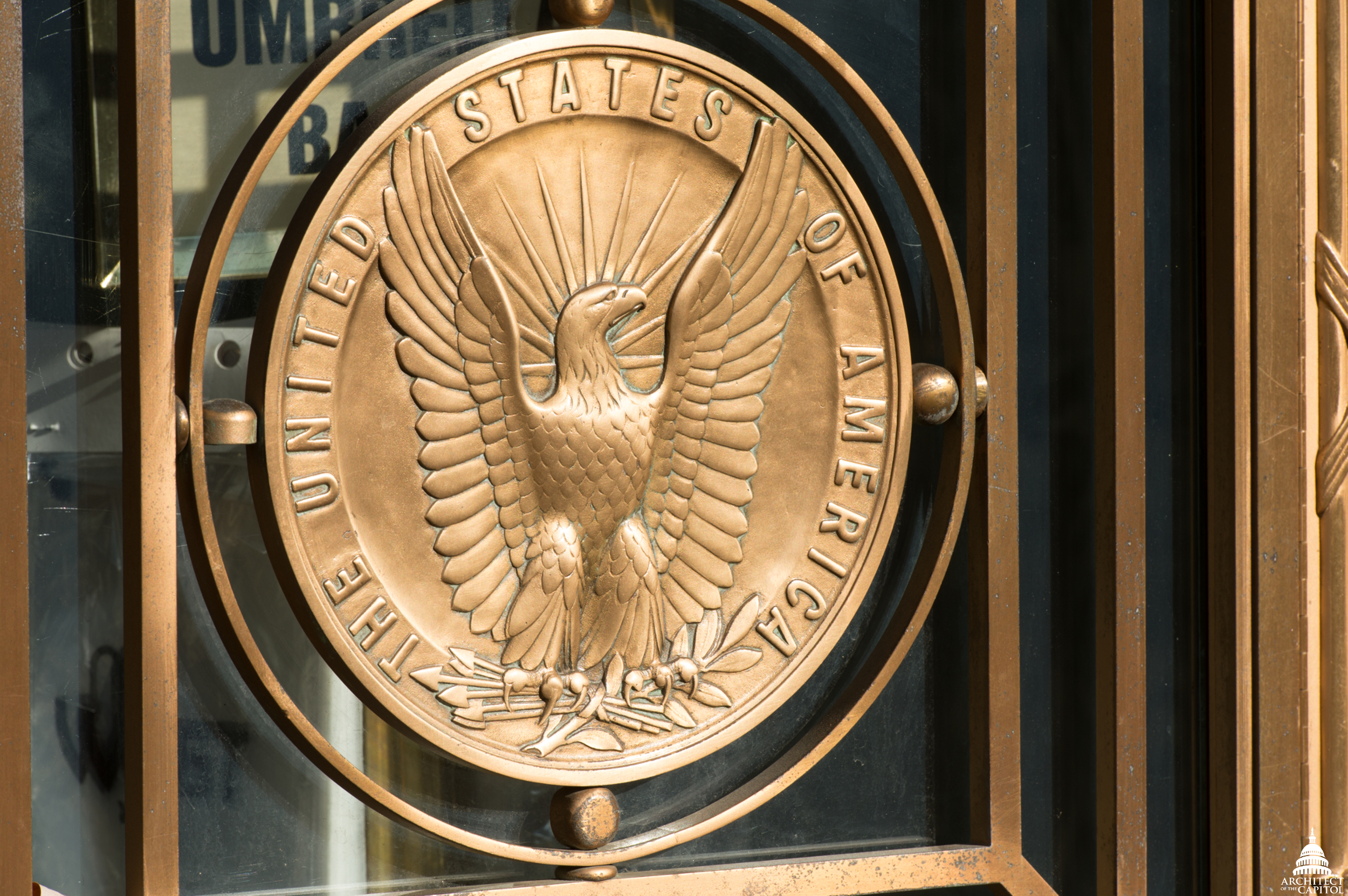 Bronze medallion with eagle the on exterior of the Dirksen Senate Office Building.