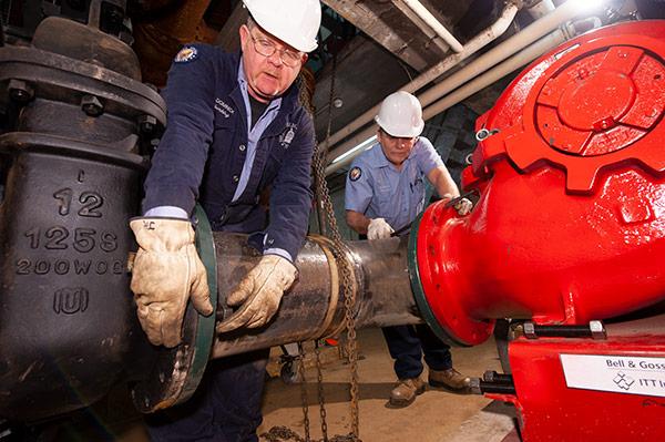 AOC Senate Office Buildings plumbing crew members.