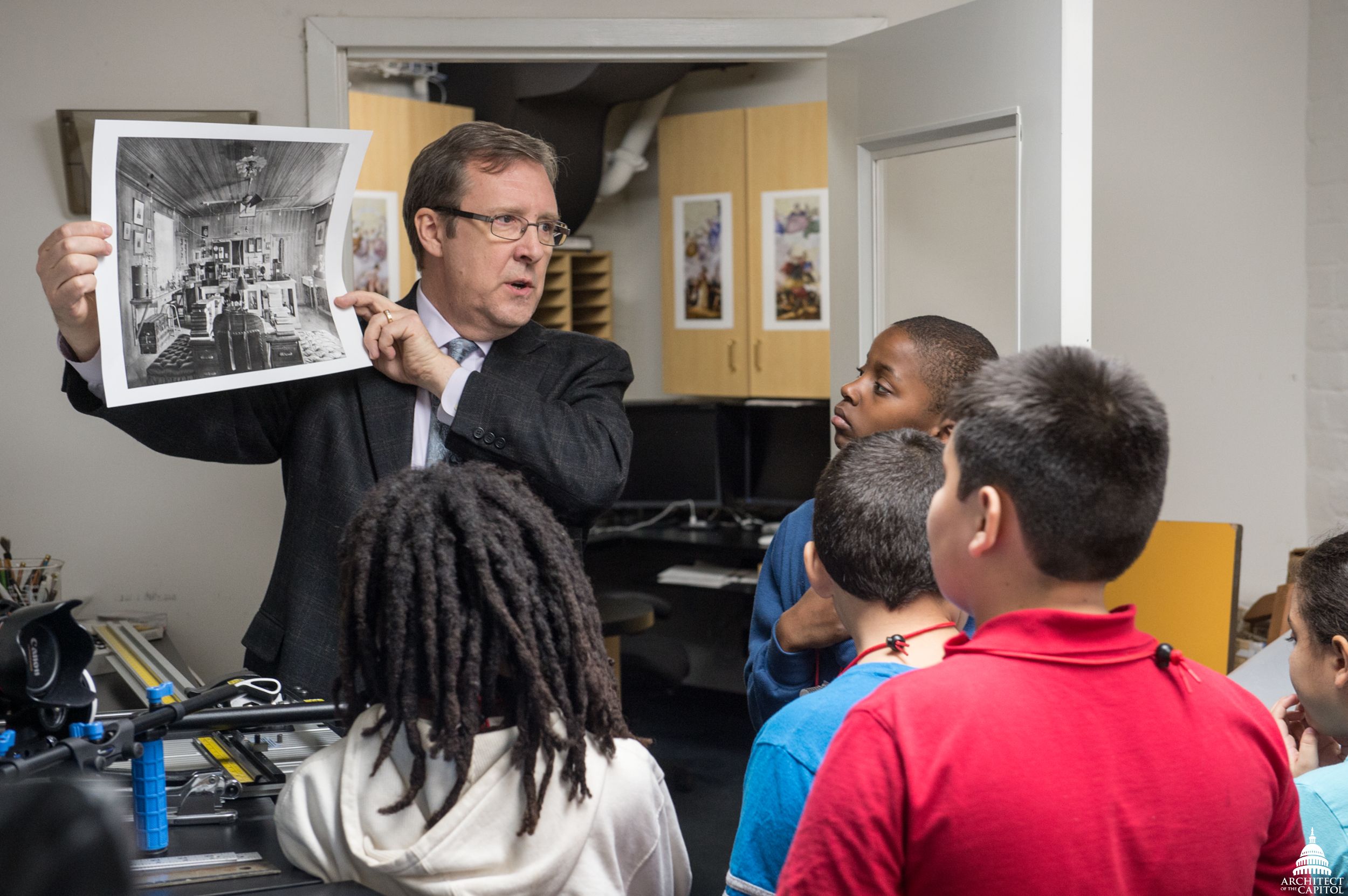 Dunn teaches children about working as a professional photographer.
