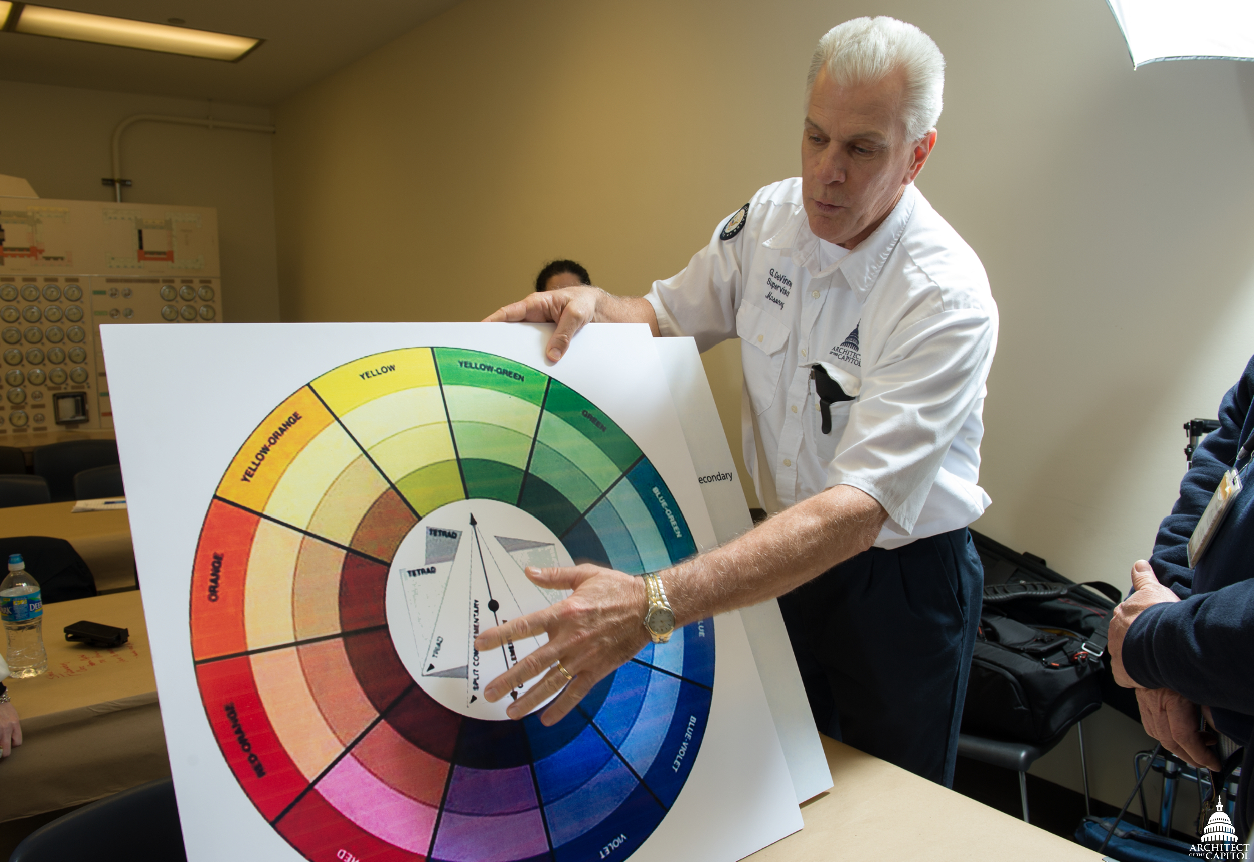 AOC's Glenn DeVinney instructs AMP employees on the basics of color matching for marble repairs.