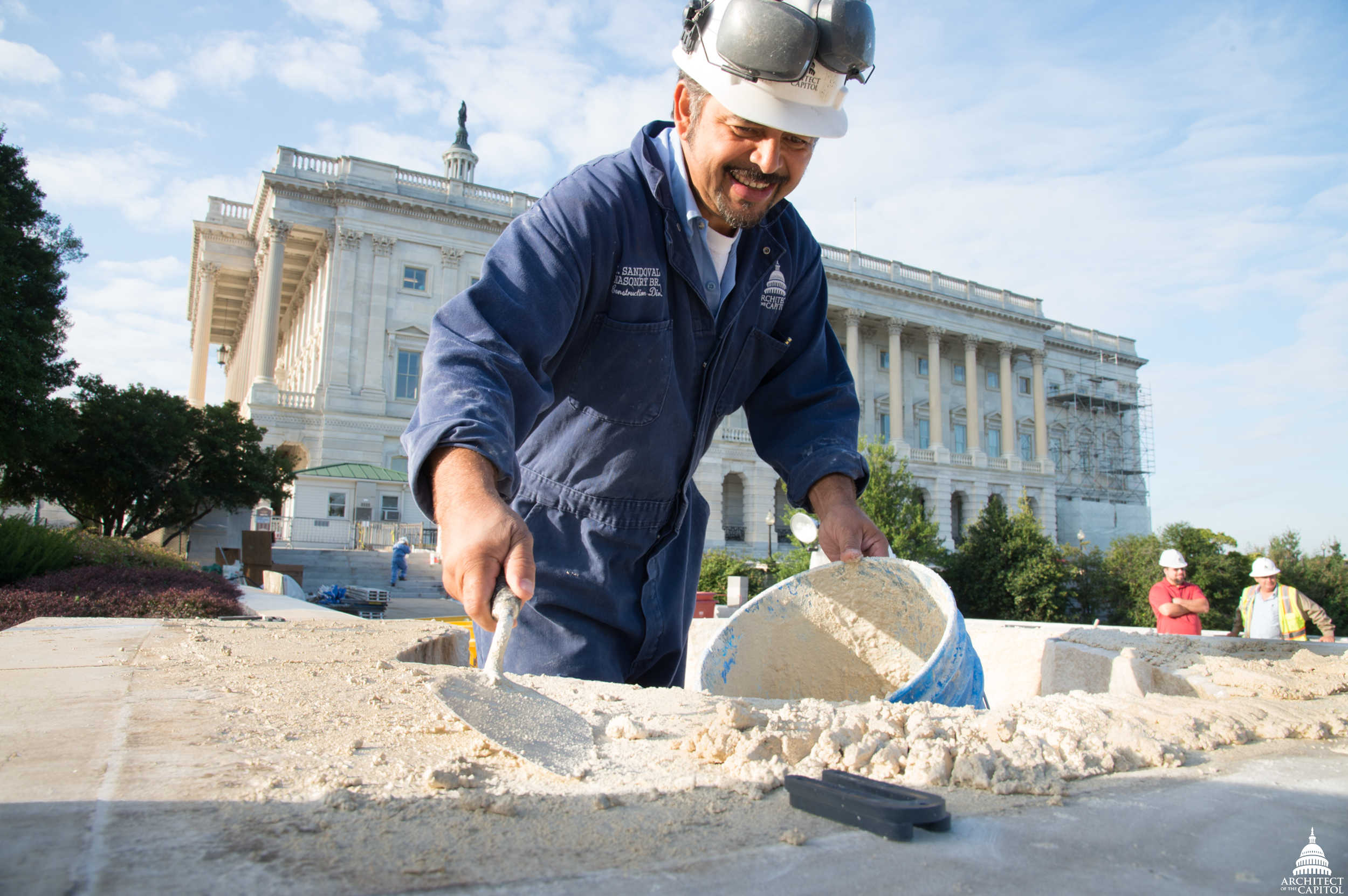 An AOC stonemason repairs the Olmsted Terrace.