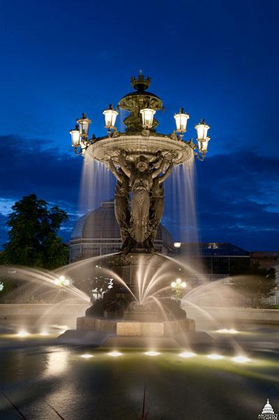 View of Bartholdi Fountain at night at the United States Botanic Garden.