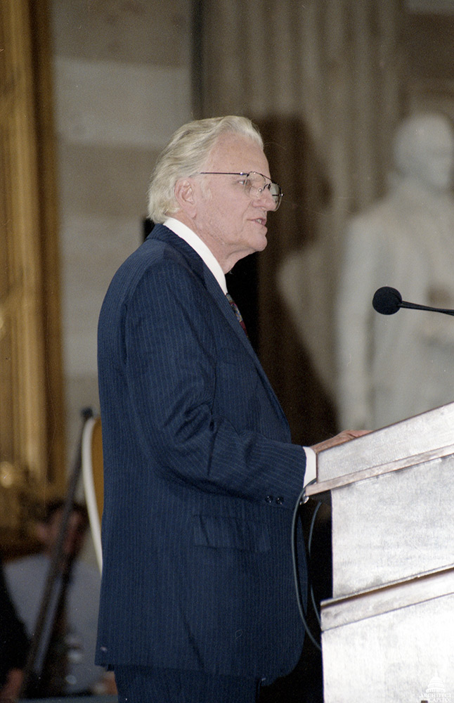 The Reverend Billy Graham giving remarks after he and his wife Ruth Graham were presented the Congressional Gold Medal in 1996.