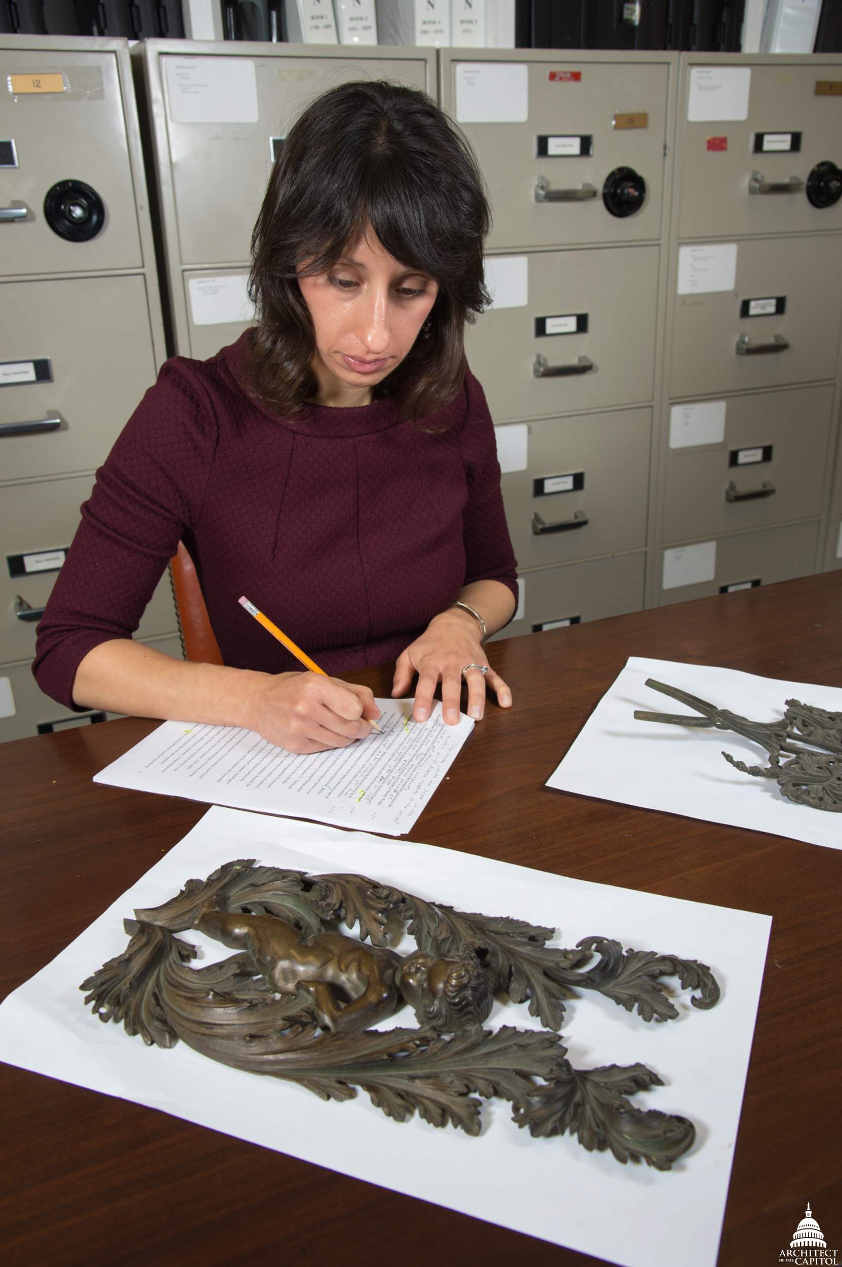 Jennifer Blancato, Office of the Curator, carefully analyzes art.