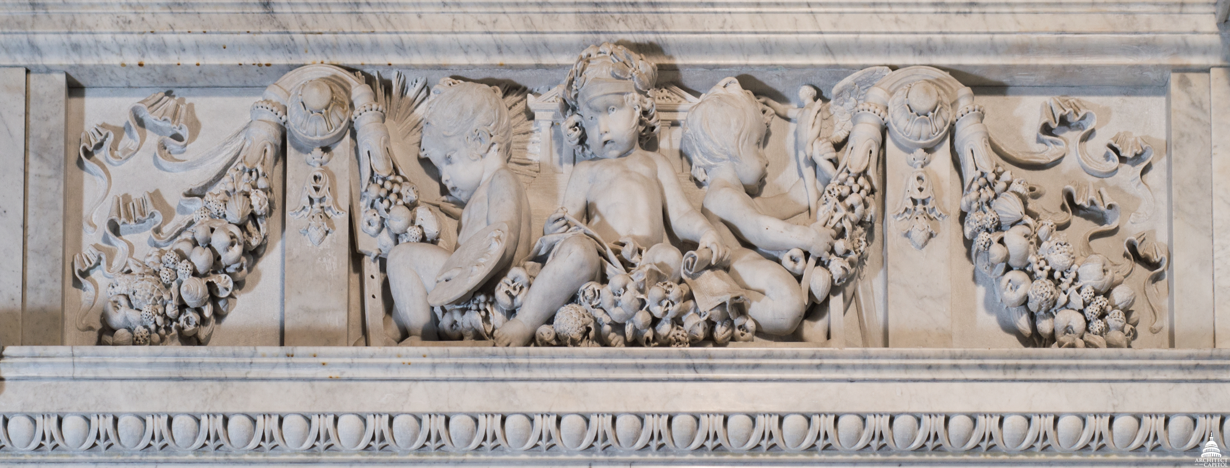 Architecture putto (center) with the Parthenon represented behind it.