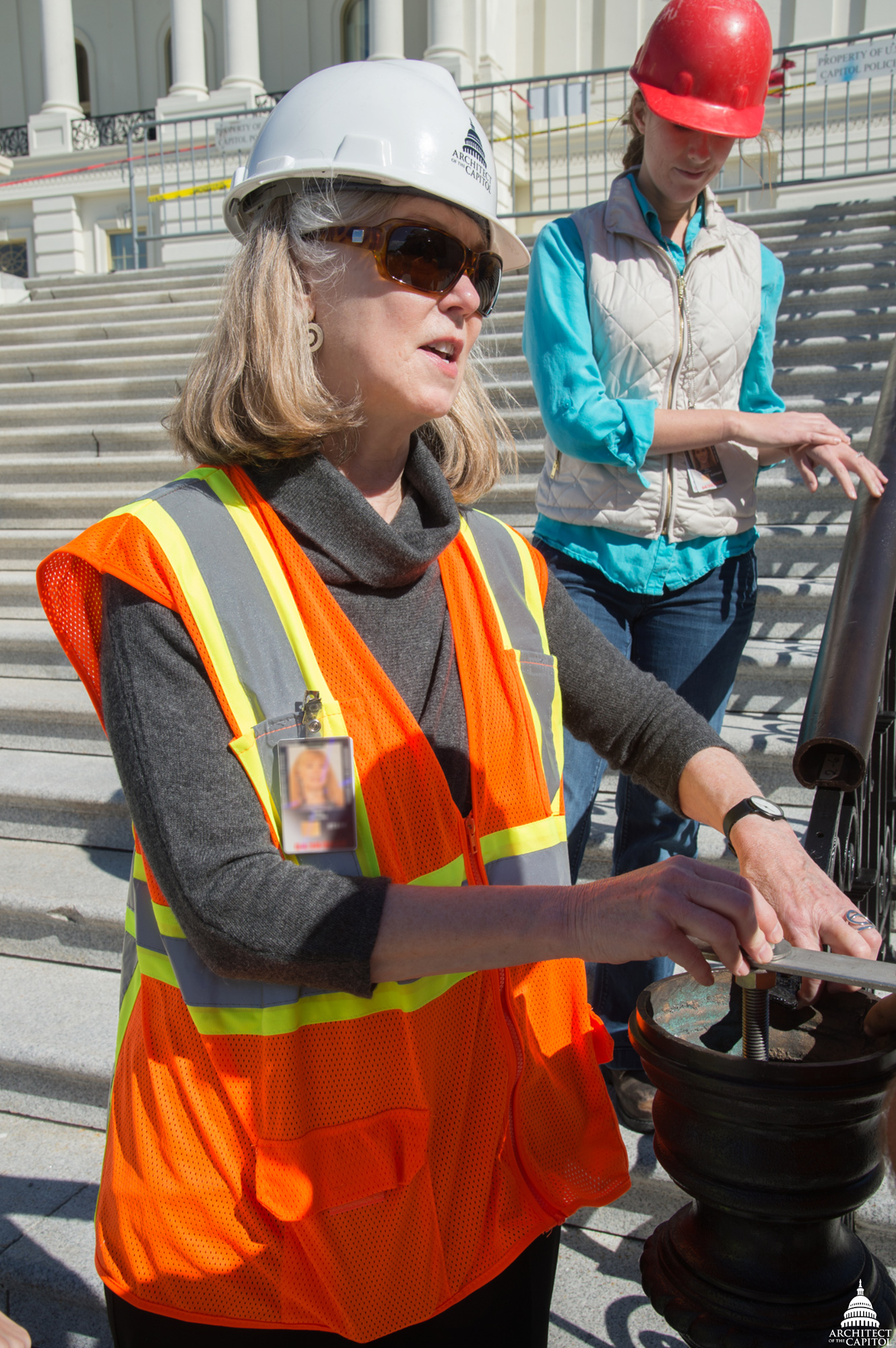 Historic Preservation Officer Mary Oehrlein inspects stone at the Capitol.