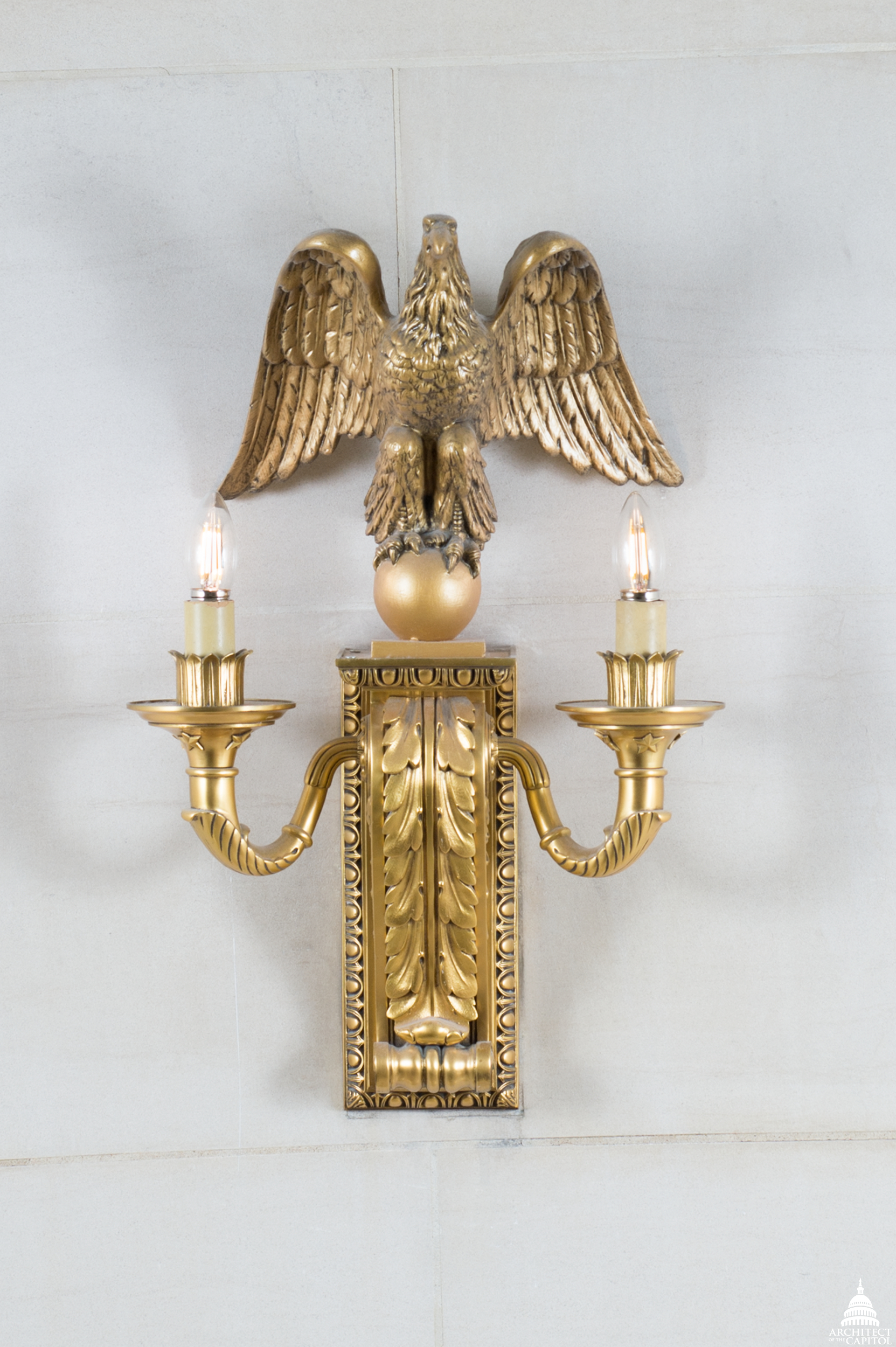 Eagle sconce or wall bracket on staircase walls in the Longworth Building.