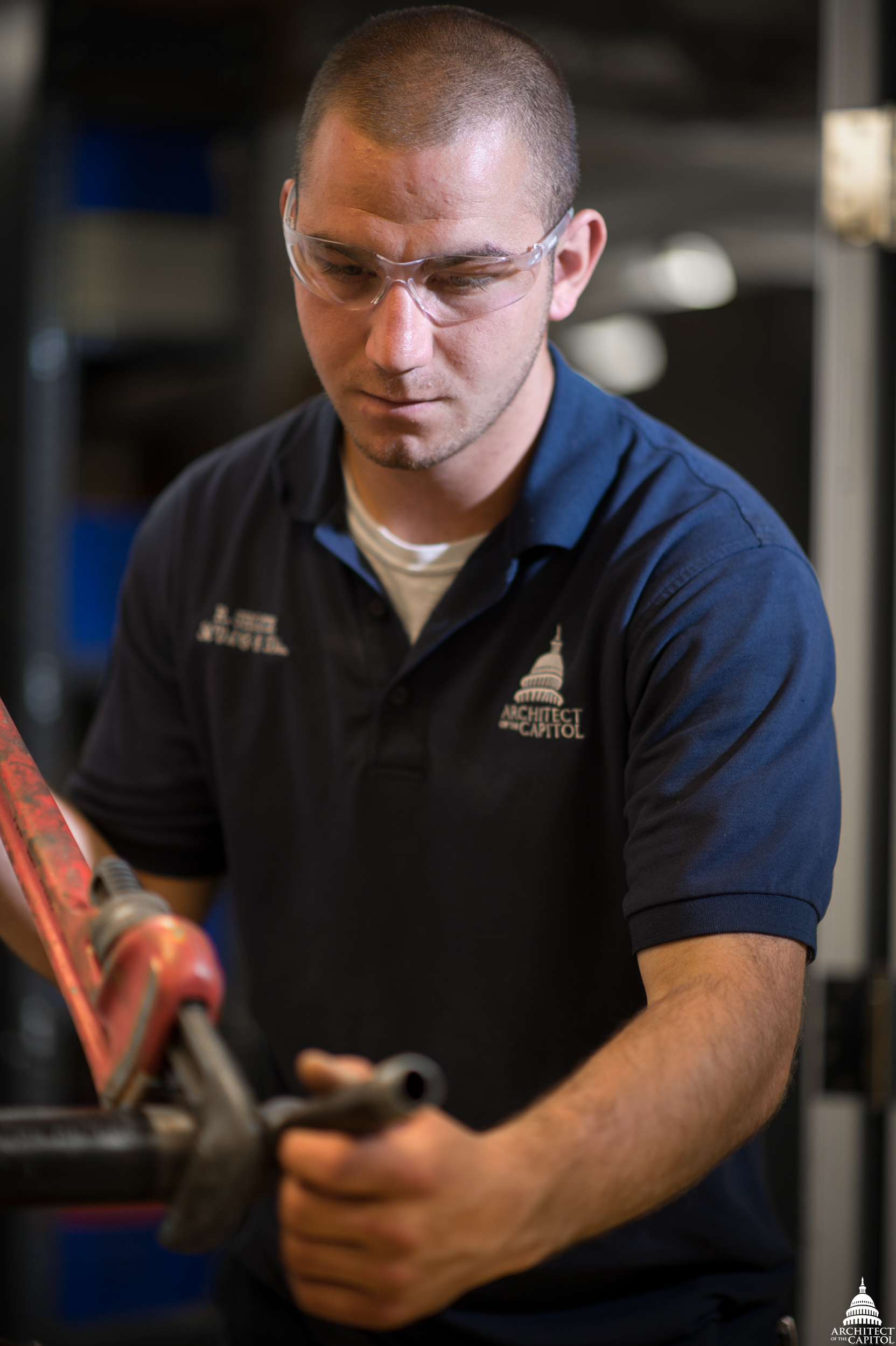 AOC's Randy Shontz, HVAC Equipment Worker, uses a wrench to fabricate a pipe.