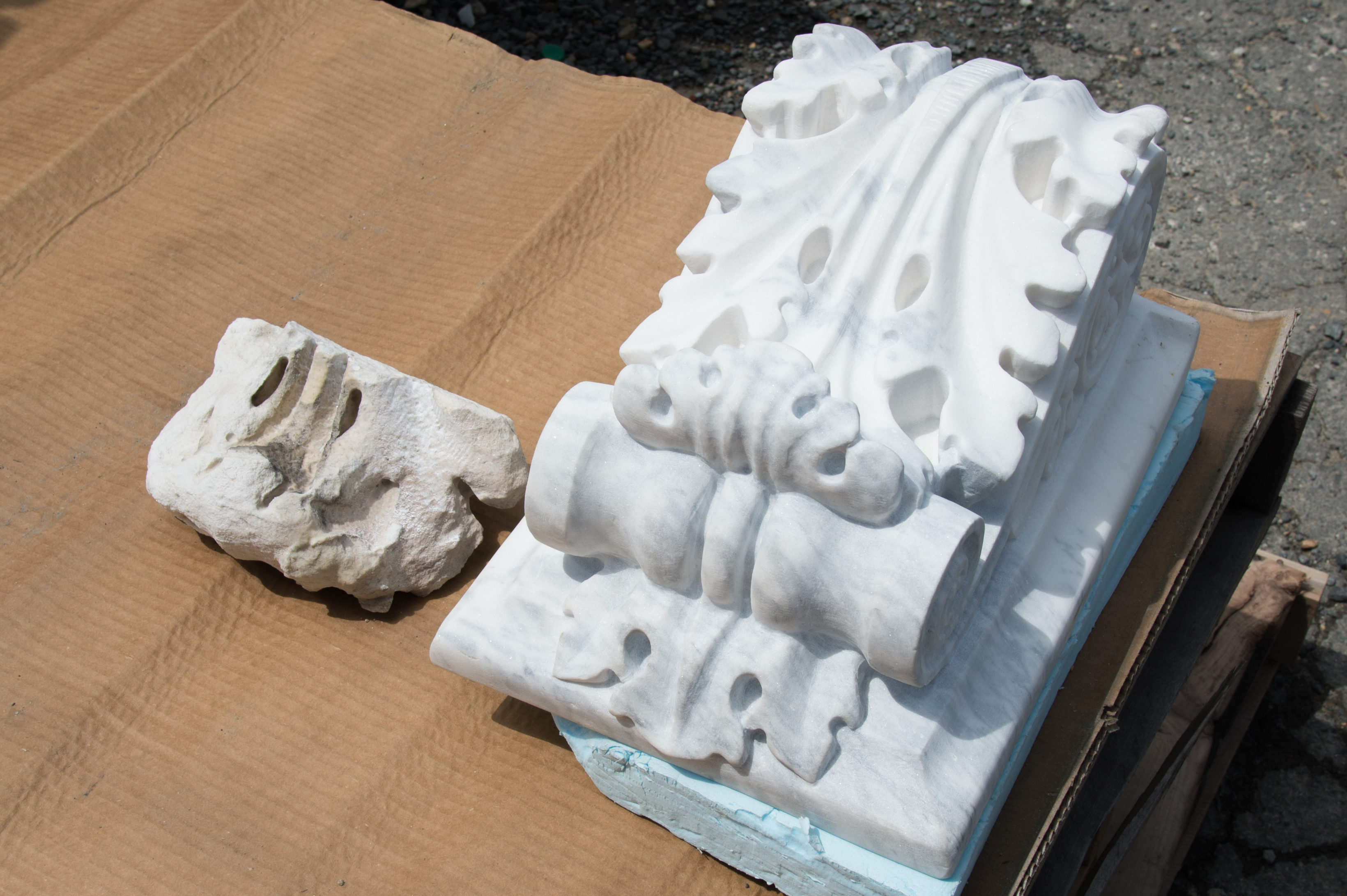 Piece of a deteriorated modillion or bracket from the U.S. Capitol (left) next to a newly carved one (right).