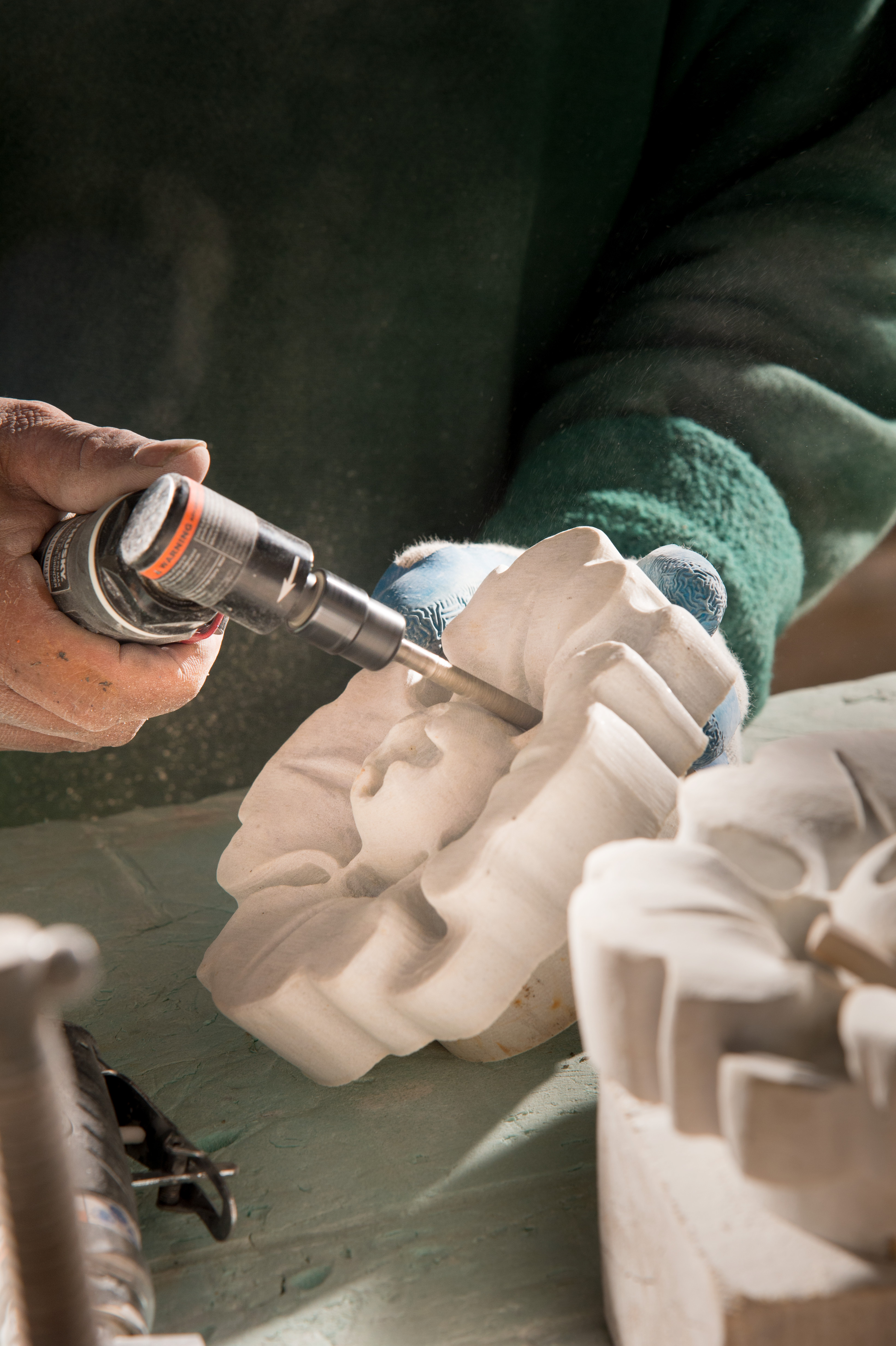 Stone rosette hand carving.