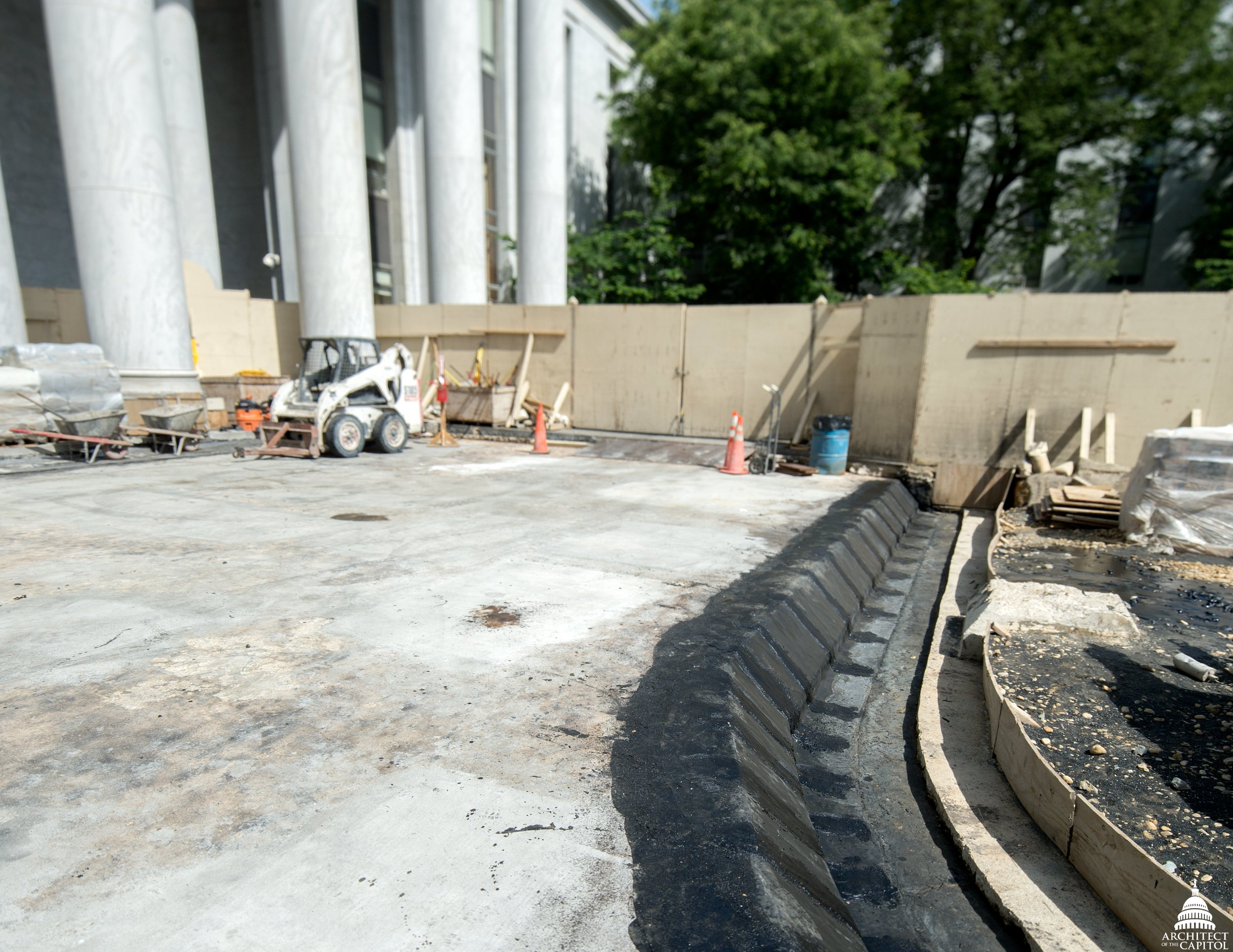 New exterior waterproofing and concrete patches are completed on the Rayburn Horseshoe courtyard.