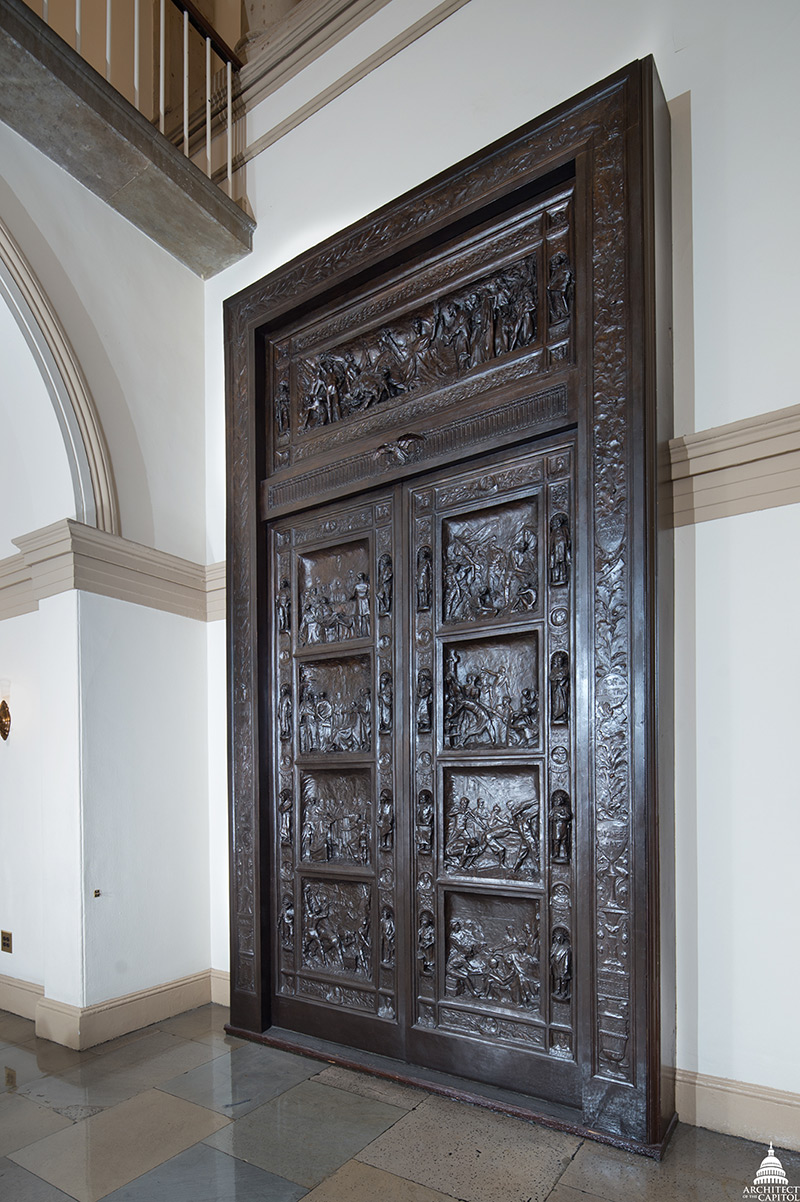 The bronze Amateis Doors on display in the House Wing of the U.S. Capitol.