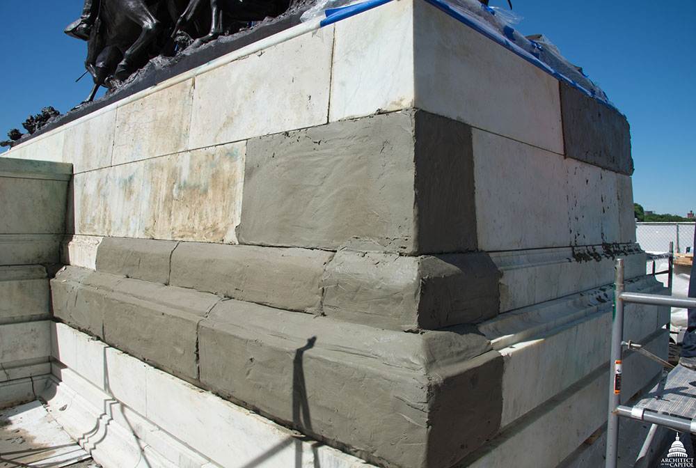 Stone being restored on the Grant Memorial.