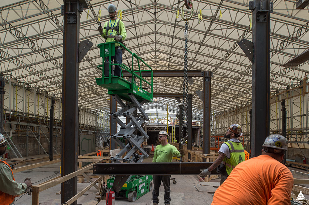 In the Cannon Building's west wing, workers install structural steel for the rebuilding of the fifth floor.