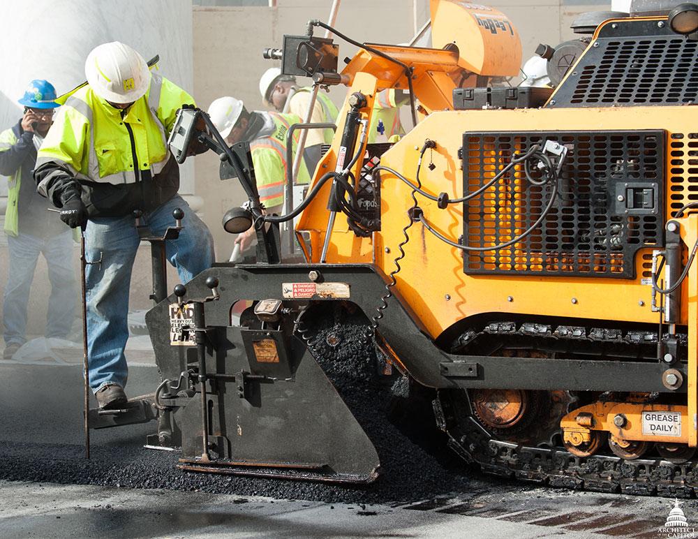 New asphalt is laid on the Rayburn Horseshoe.