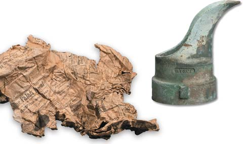 Newspaper and bronze spout found during the Cannon Renewal project.