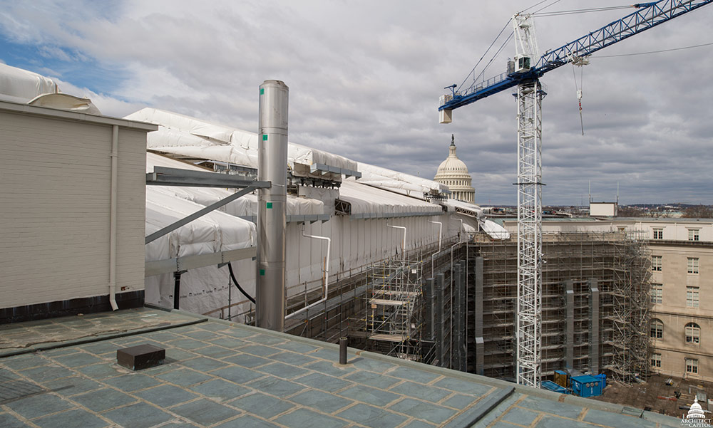 View of the Cannon Renewal crane and west wing roof protection with a view of the U.S. Capitol dome.