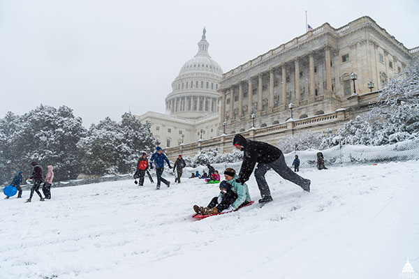 Visitors sledding on the snow at the U.S. Capitol in 2018.