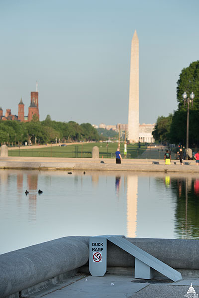 One of the duck ramps at the Capitol Reflecting Pool with the Washington Monument seen in the background.