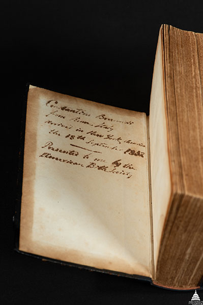 This Bible once belonged to Constantino Brumidi, a U.S. Capitol artist. The cover is open showing Brumidi's inscription.