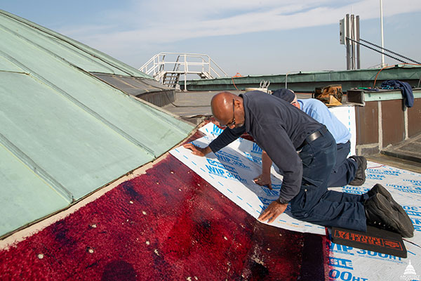 Waterproof membrane being installed before the copper wall flashing is placed at the base of the U.S. Capitol Senate cupola.