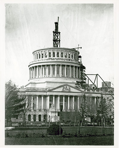 Wooden scaffold extended and temporary roof over the Capitol Rotunda raised during Dome construction.