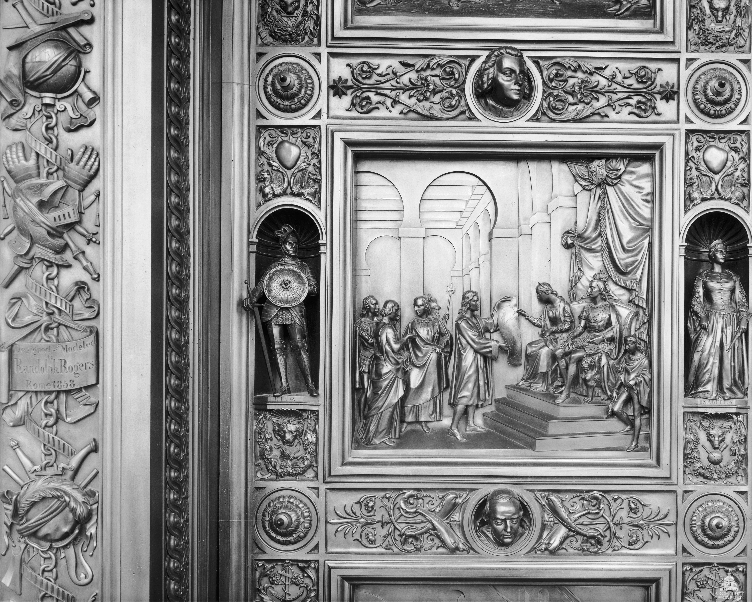 This panel of the Columbus Doors depicts Queen Isabella listening attentively to Columbus's explanation of his map, with King Ferdinand at her side.