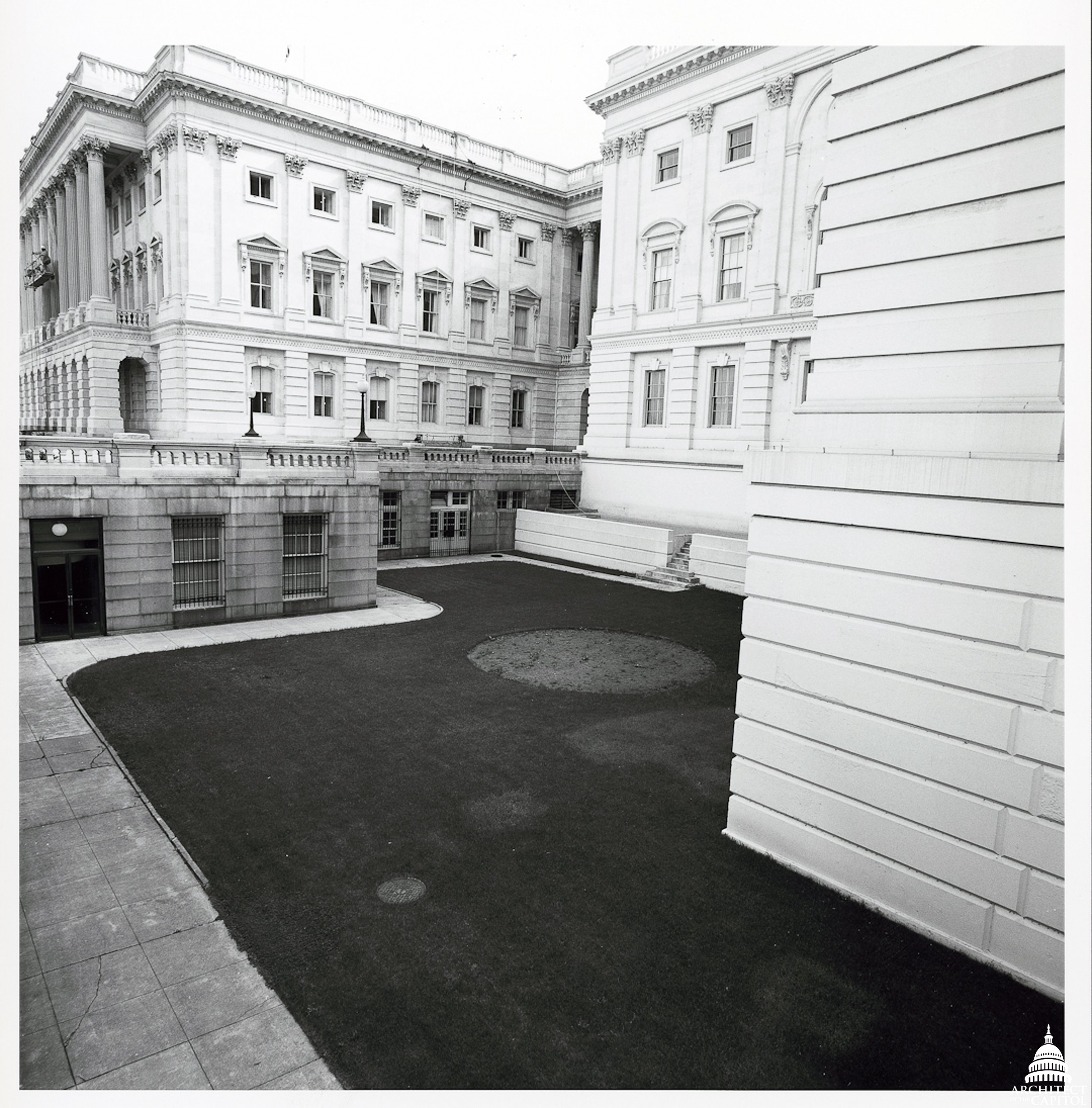 View of the U.S. Capitol before the courtyards were transformed into meeting rooms, offices and connecting hallways in the building's basement level.