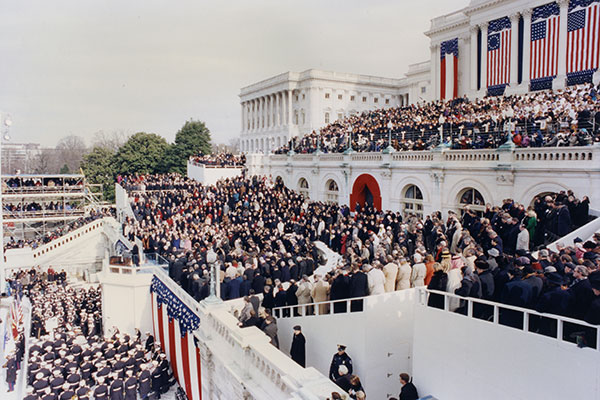 View of the presidential inauguration platform and guests at the U.S. Capitol.
