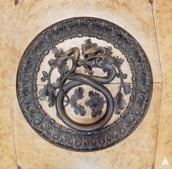 Bronze door handle on maple doors to the chamber of the House of Representatives in the shape of a snake.