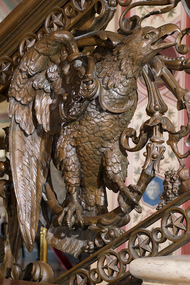 Close-up view of an eagle in a bronze staircase of the Brumidi Corridors.