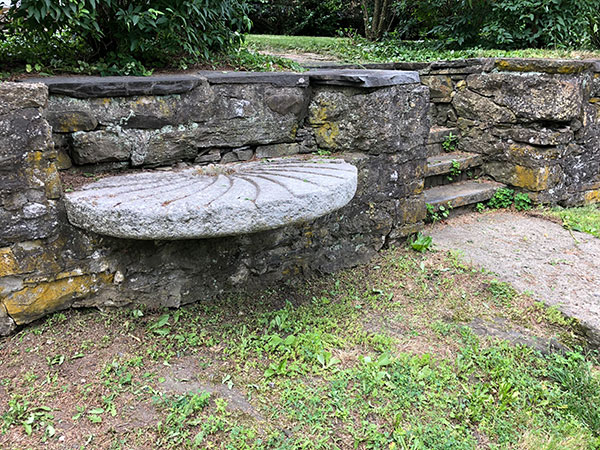 A bench made of millstone in the wall became a marker for the De Witt house location.