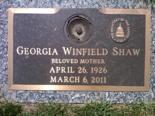 Photo of Georgia Shaw's memorial plaque with the AOC logo.