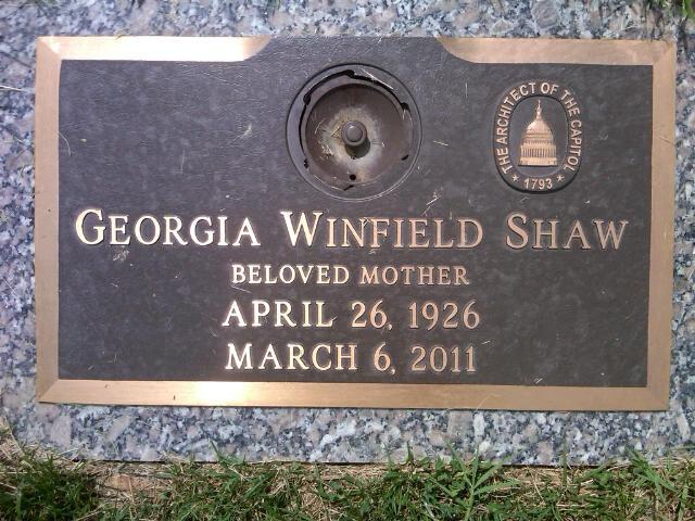 Photo of Georgia Shaw's memorial plaque with the AOC logo.