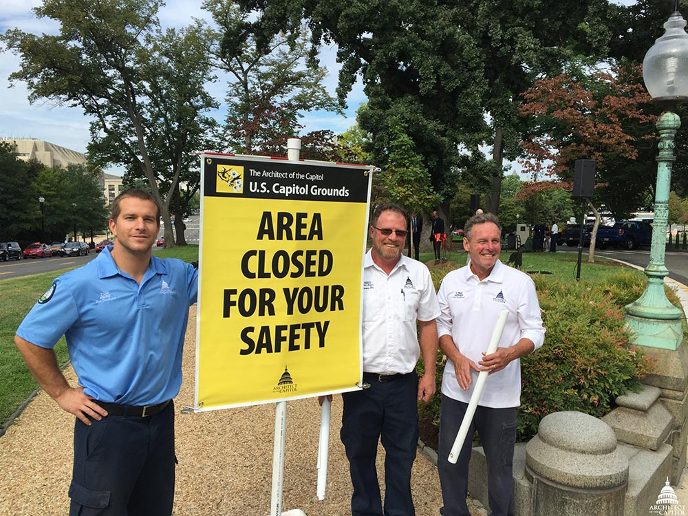 Group photo of members of the AOC Capitol Grounds team with the Safety Sign.