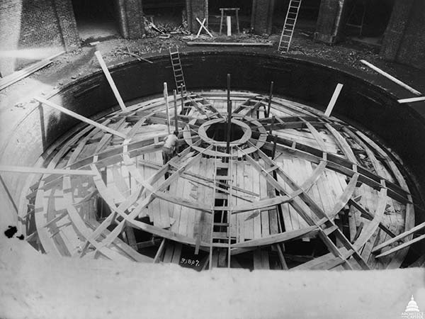 This March 1907 photo shows the Guastavino Company's building of the wooden arch forms over the Cannon House Office Building sub-basement rotunda.