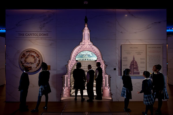 A school group explores the 11-foot-tall touchable scale model of the U.S. Capitol dome in the Capitol Visitor Center's Exhibition Hall.