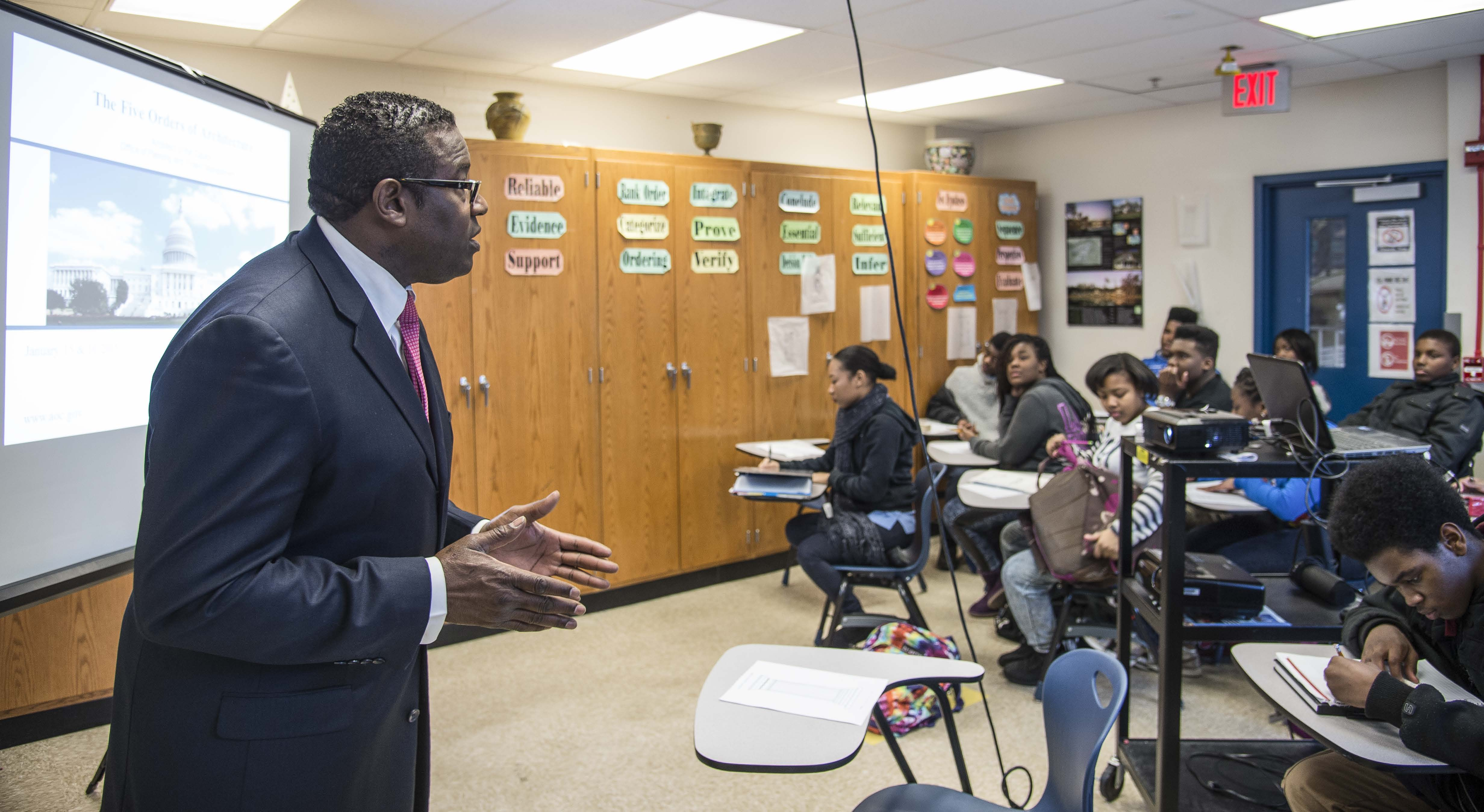 "AOC architect Eugene Poole teaches a class on ""The Five Orders of Architecture"" to students at Phelps High School."
