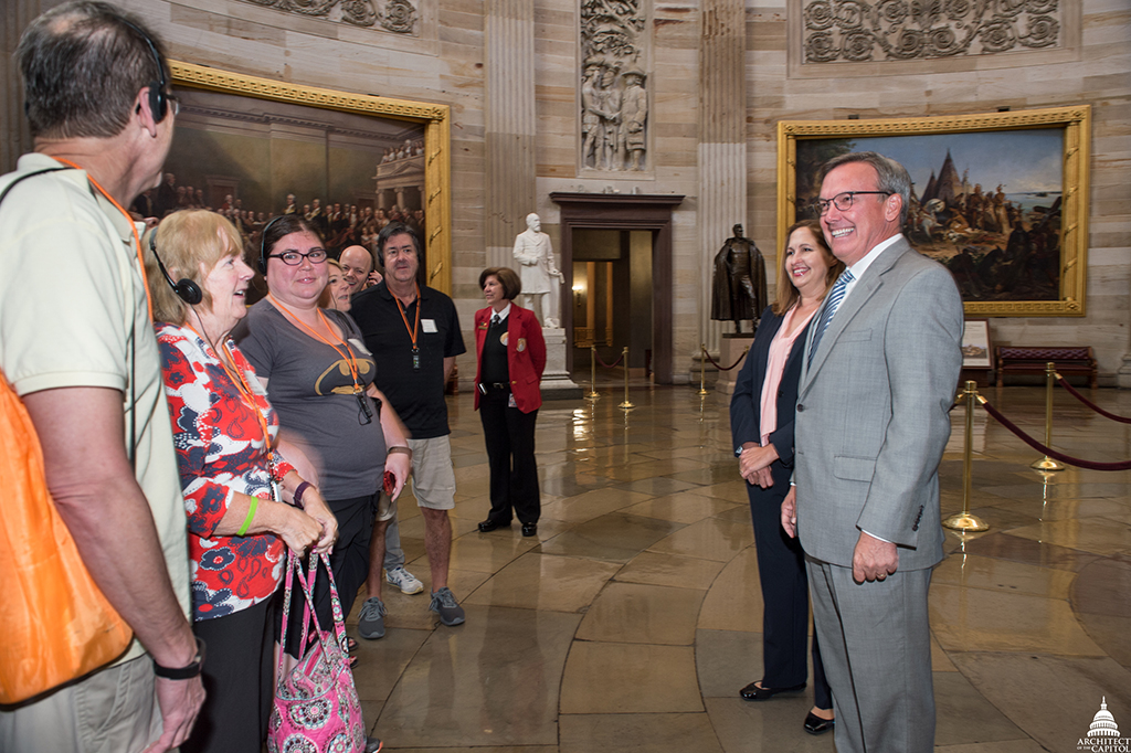Architect of the Capitol Stephen T. Ayers greets the first tour group in the Rotunda.
