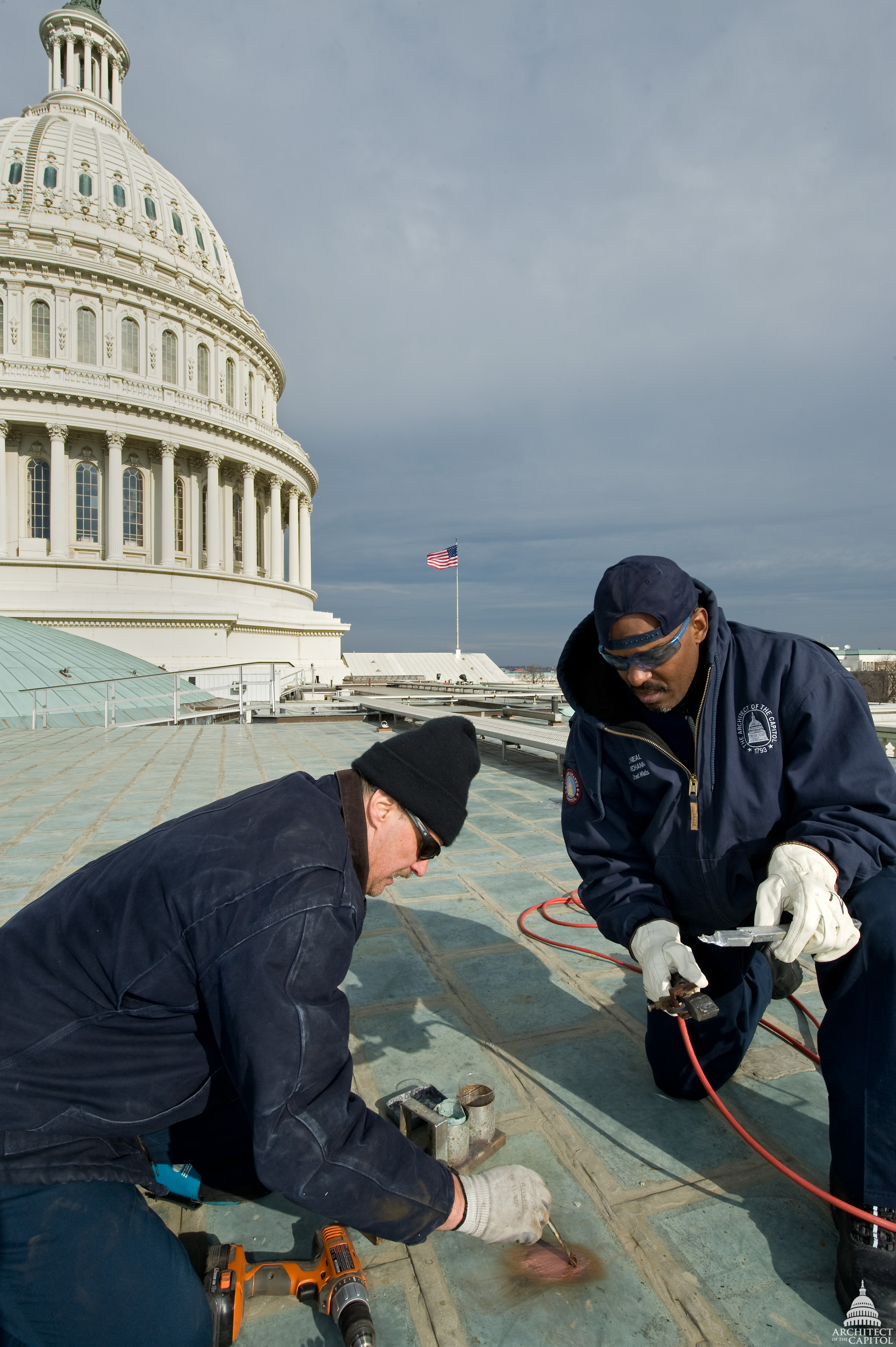 AOC employees patch the roof of the U.S. Capitol