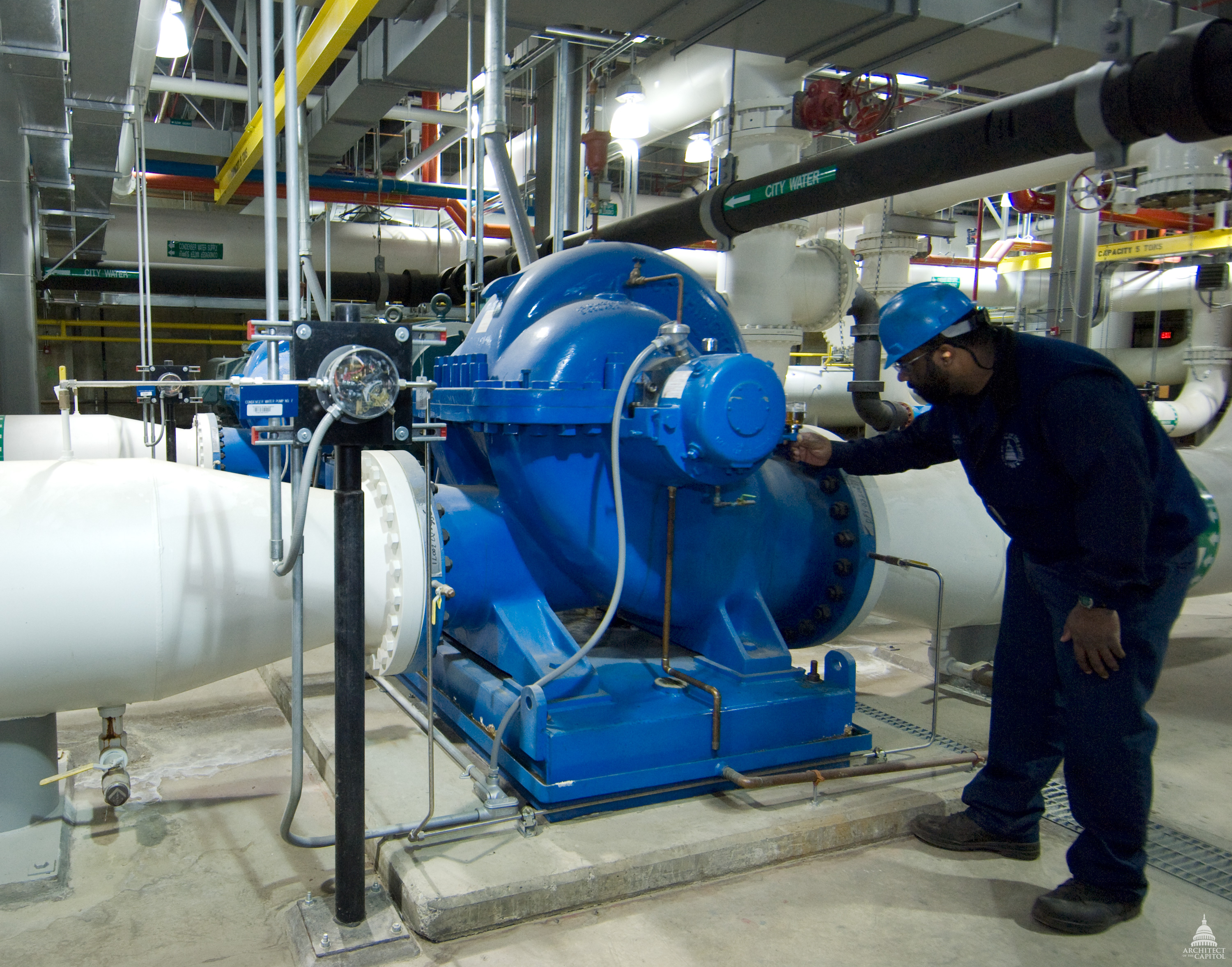 An AOC Capitol Power Plant employee inspects the equipment to ensure it is reliable every day of the year.