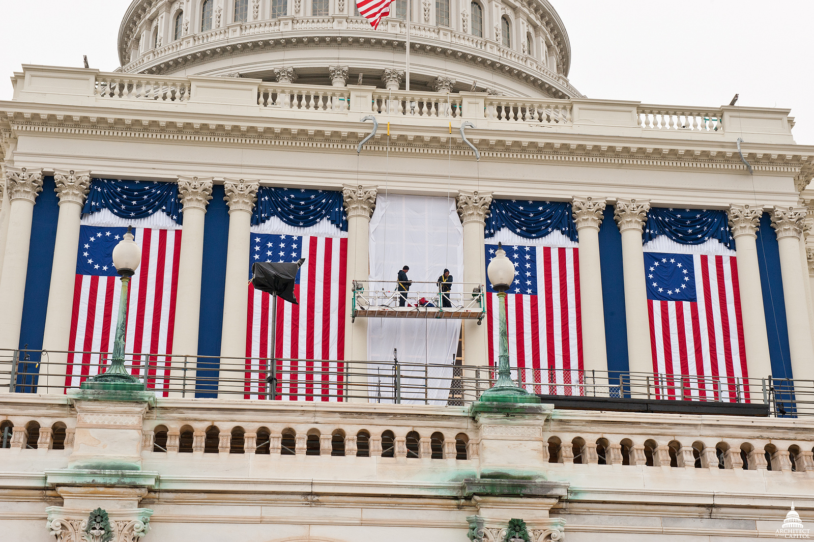AOC employees hang flags and bunting in preparation for the 2009 Inaugural
